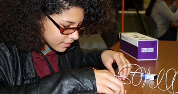 Sixth-grader Selena Williamson learns circuitry basics hands-on.