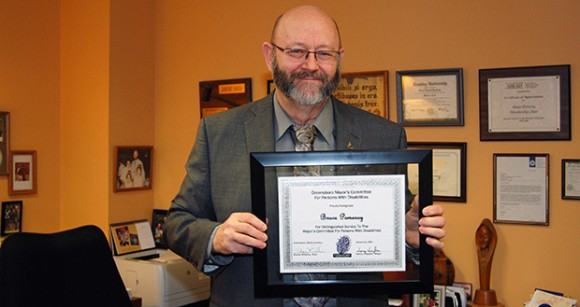 "Bruce Pomeroy, Director of the Office of Accessibility Resources and Services (OARS) was recently recognized for his ""distinguished service"" to the Greensboro Mayor's Committee for Persons with Disabilities by Mayor Nancy Vaughan and the committee."