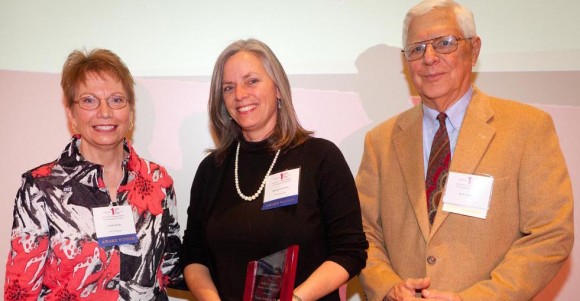 Chancellor Linda P. Brady and faculty member Spoma Jovanovic pose with service-learning pioneer Robert L. Sigmon, the namesake of the award won by Jovanovic