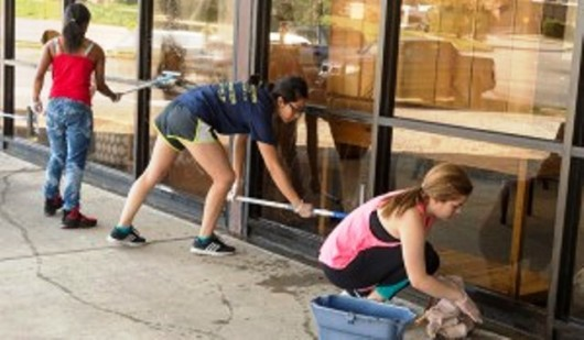 volunteers washing windows